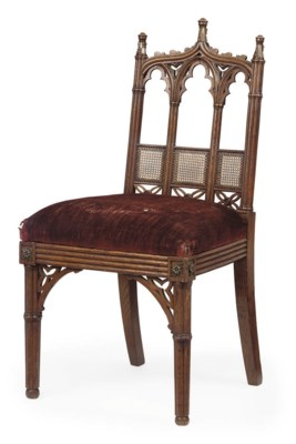 A GEORGE IV 'GOTHIC' OAK CHAIR