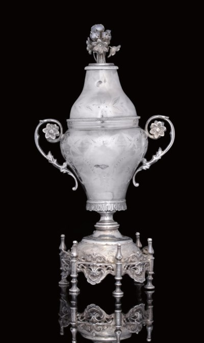 AN OTTOMAN SILVER COVERED VASE