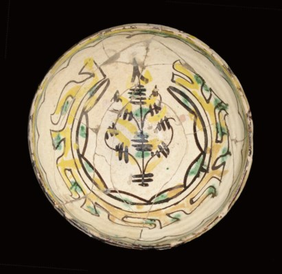 A NISHAPUR POTTERY BOWL WITH P