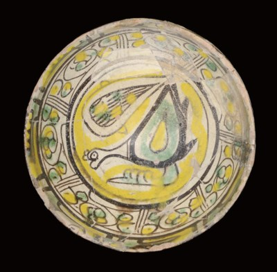 A NISHAPUR POTTERY BOWL WITH B
