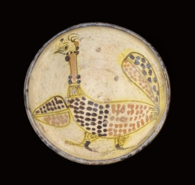 A POTTERY BOWL WITH PEACOCK, E