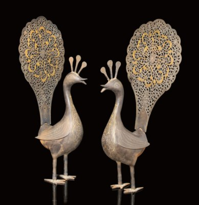 A PAIR OF DAMASCENED STEEL PEA