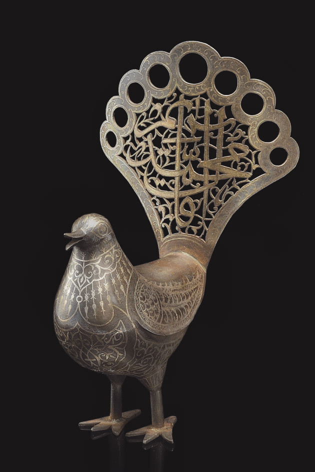 A DAMASCENED QAJAR BIRD WITH O