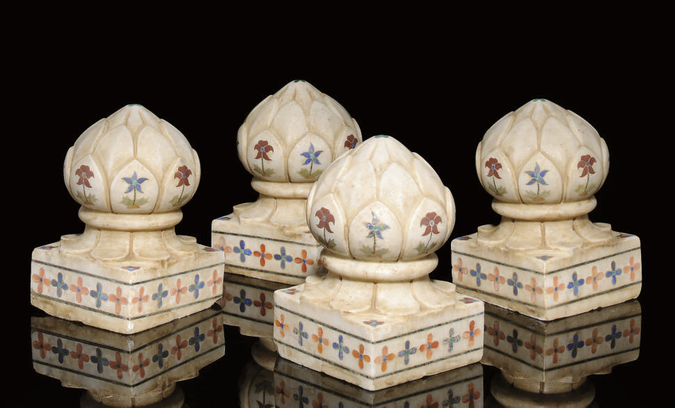 FOUR MARBLE CARPET WEIGHTS WIT