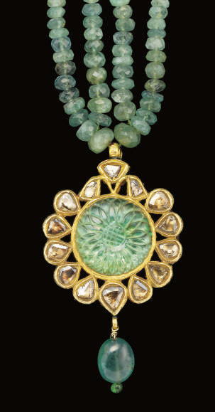 AN EMAMELLED GOLD AND EMERALD