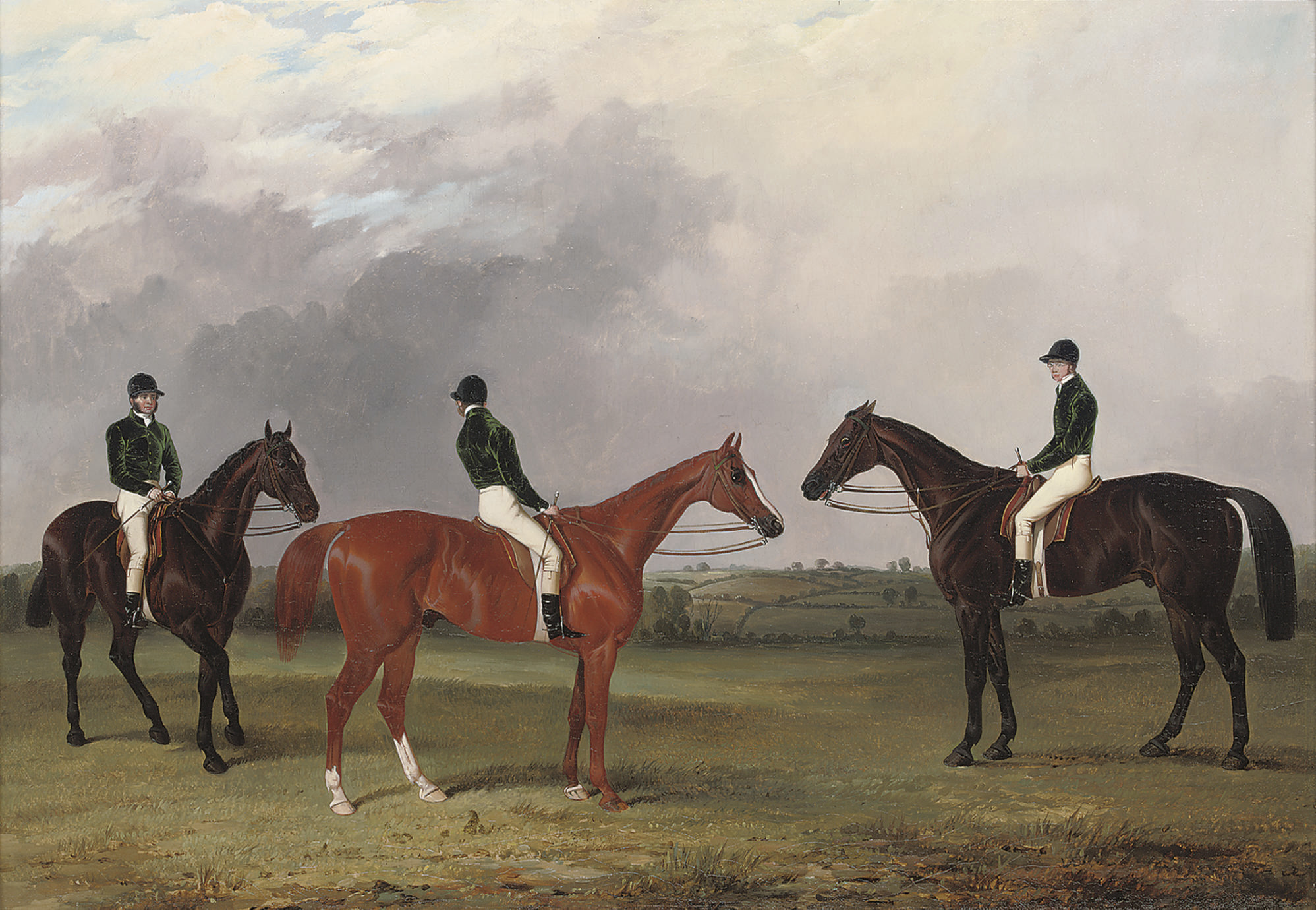 A chestnut and two bay racehorses belonging to John Bowes with jockeys up