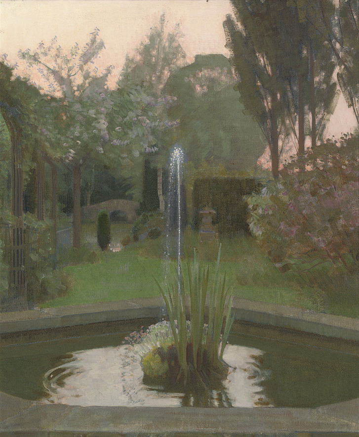 Garden pond with fountain at dusk