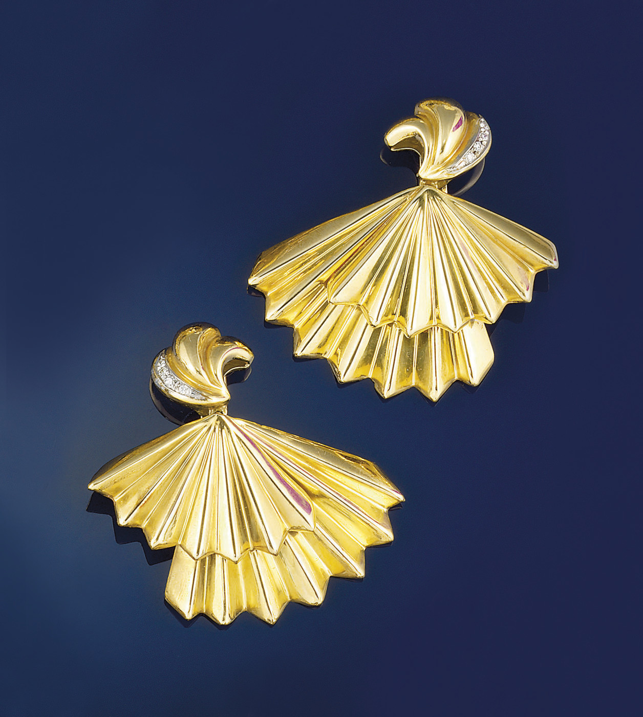A pair of diamond set earpenda