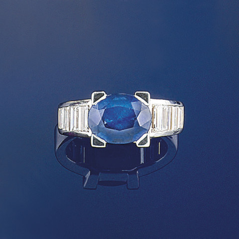 A sapphire and dimond ring, by