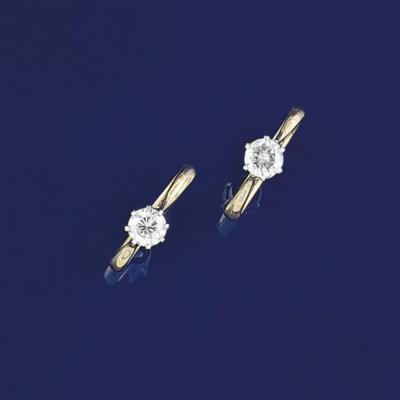 Two diamond single stone rings