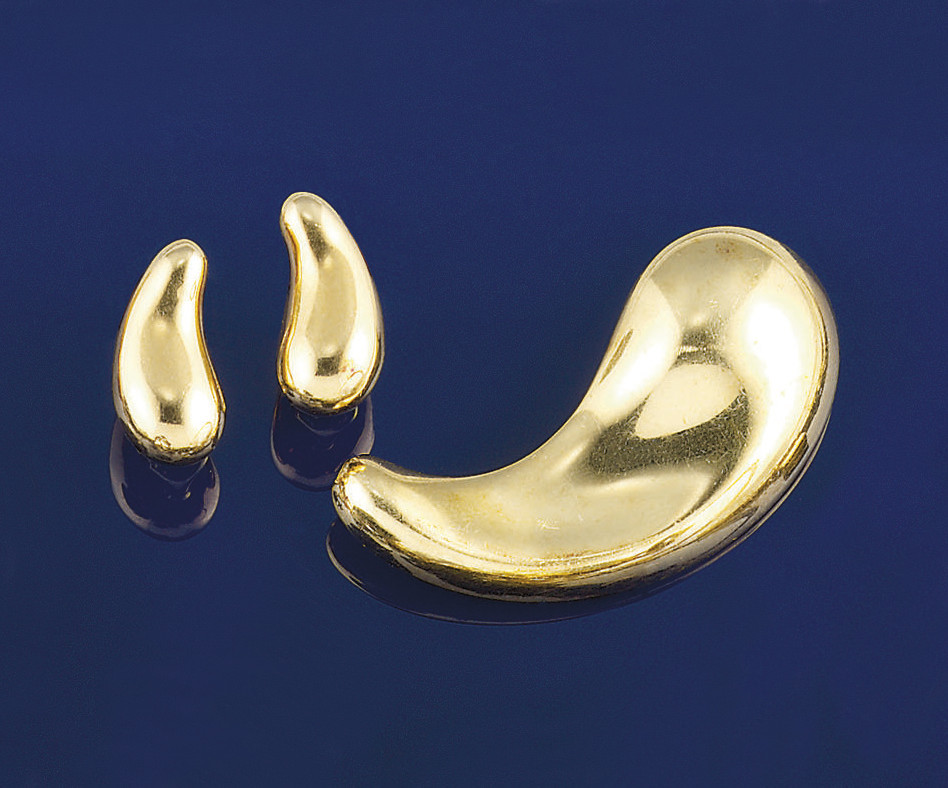 A pair of earclips and a brooc