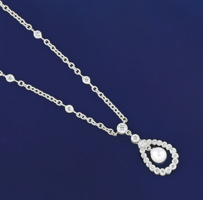 A CULTURED PEARL BRACELET AND