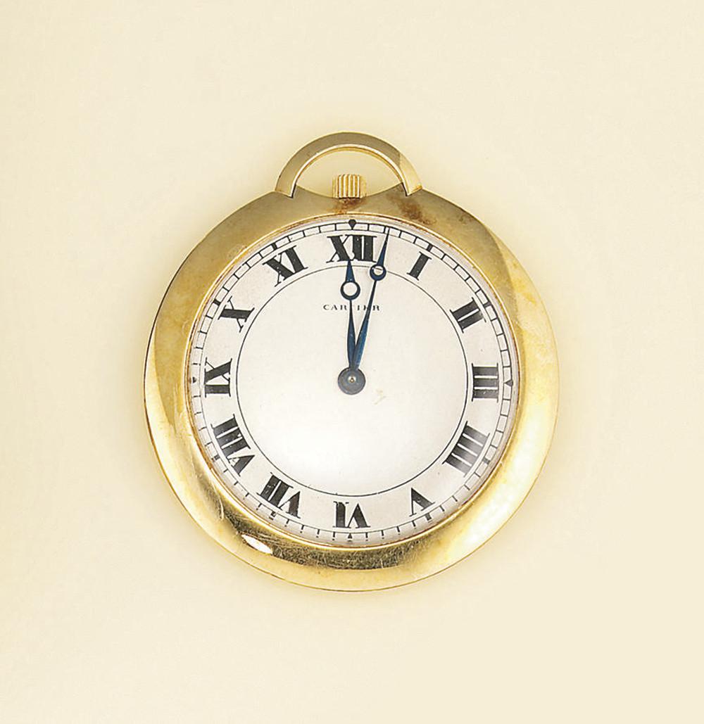 A dress watch, by Cartier