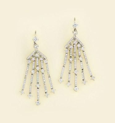 A pair of diamond tassel earpe