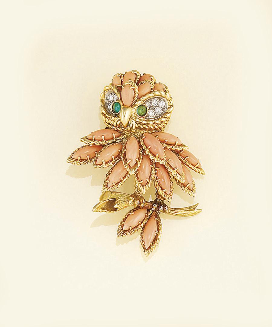 A diamond, coral and emerald o