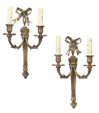 A PAIR OF GILT BRASS TWIN-BRAN