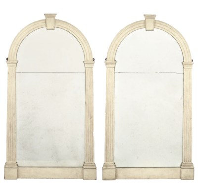 A PAIR OF PAINTED WALL MIRRORS