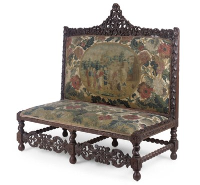 AN OAK AND TAPESTRY UPHOLSTERE