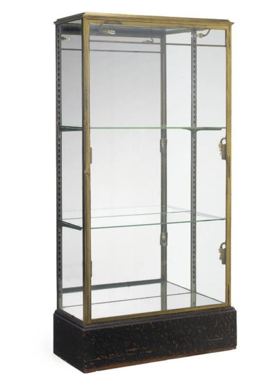 A GLAZED LACQUERED BRASS DISPL