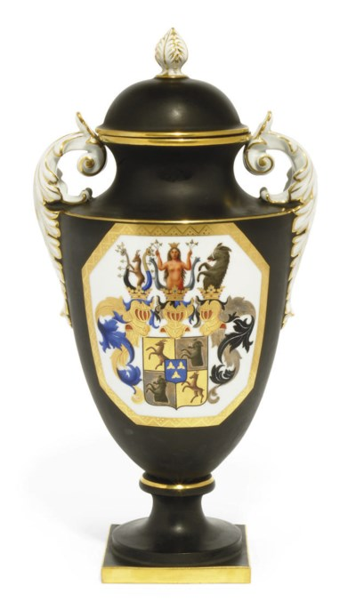 A PORCELAIN ARMORIAL VASE AND