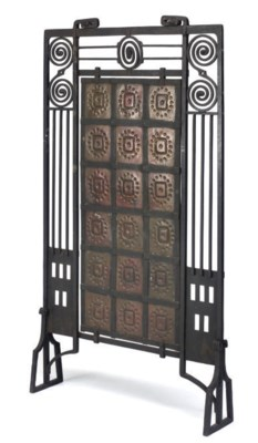 A FRENCH WROUGHT IRON FIRESCRE