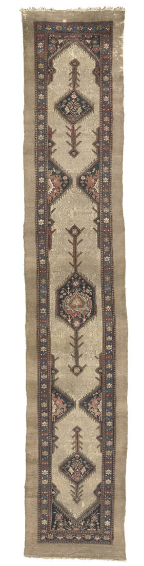 An antique Serapi runner