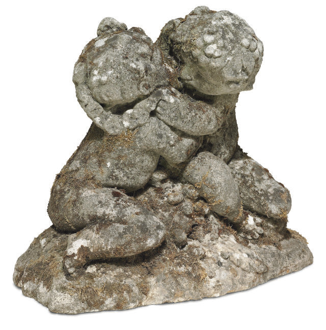 A LIMESTONE GROUP OF TWO EMBRA
