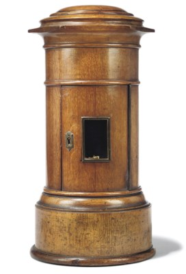 A VICTORIAN OAK PILLAR-BOX LET
