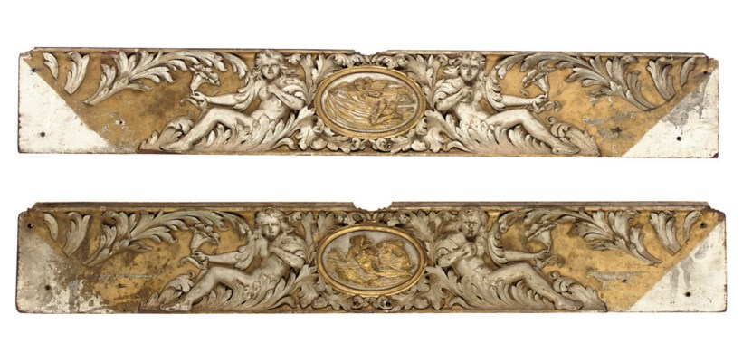 A PAIR OF CARVED WOOD RELIEF P
