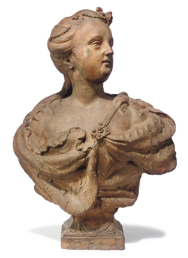 A TERRACOTTA BUST OF A WOMAN