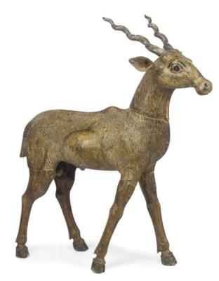 AN INDIAN WOOD MODEL OF A DEER