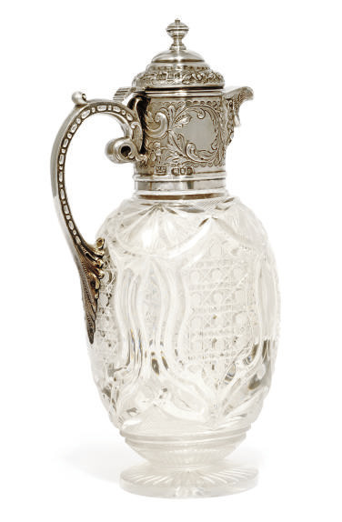 AN EDWARDIAN SILVER-MOUNTED CU
