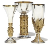 A GROUP OF THREE MODERN PARCEL-GILT SILVER COMMEMORATIVE GOBLETS