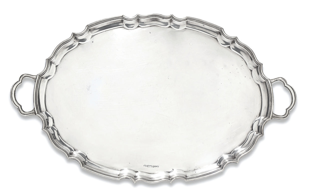 A SHAPED OVAL SILVER TWO-HANDLED TRAY