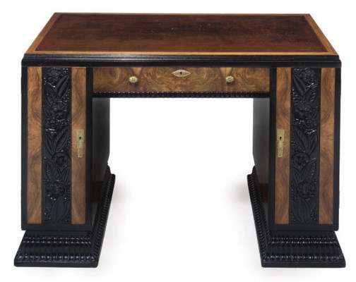 AN ART DECO WALNUT, CARVED AND