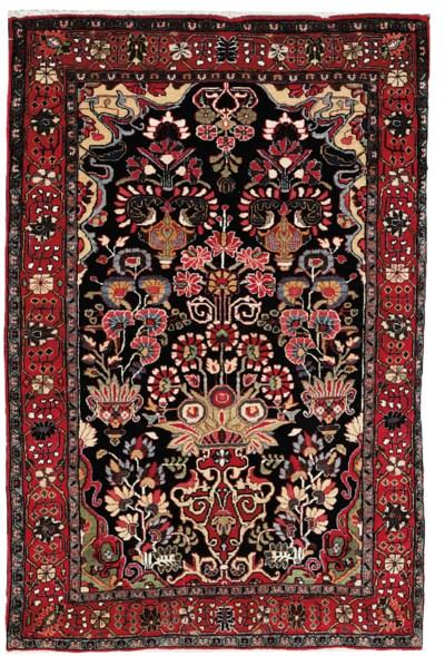 A fine Sarouk rug & part silk