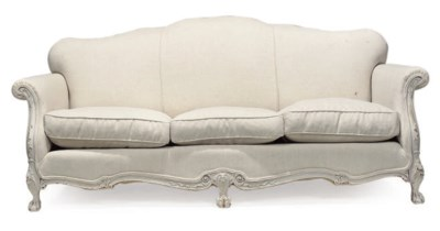 A WHITE PAINTED SOFA