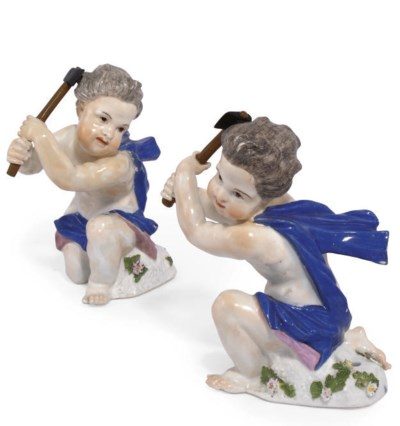 TWO MEISSEN FIGURES OF A PUTTO