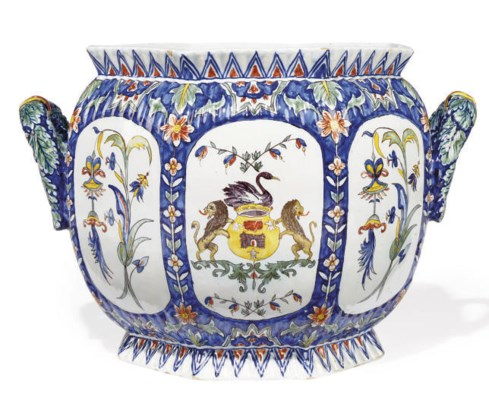 A CONTINENTAL FAIENCE TWO-HAND