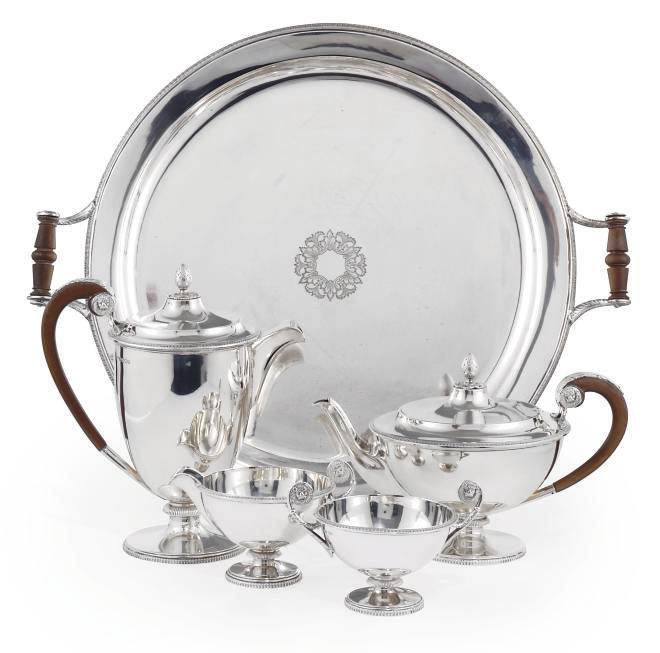 A FOUR-PIECE SILVER TEA SERVICE WITH ELECTROPLATED TWO-HANDLED TRAY EN SUITE