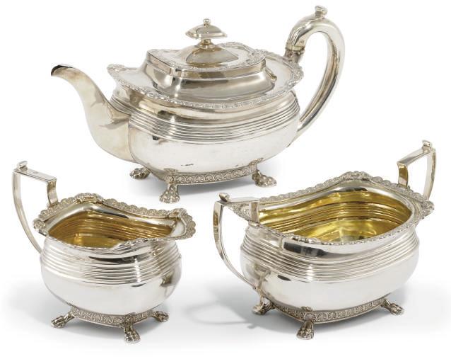 A GEORGE III SILVER THREE-PIECE TEA SET
