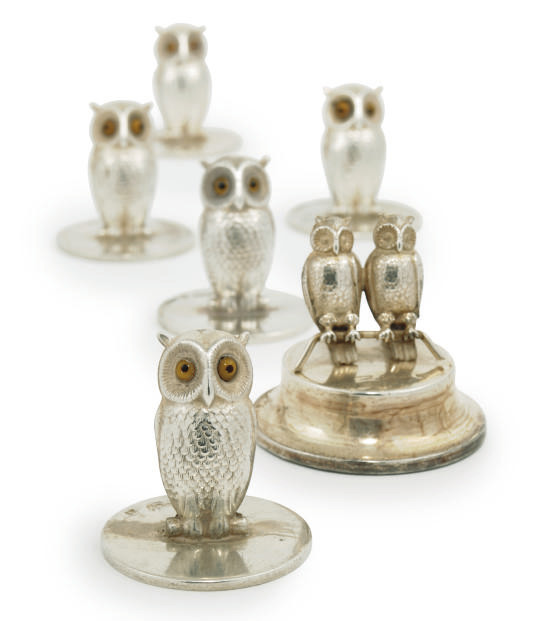 A MATCHED SET OF FIVE NOVELTY EDWARDIAN AND LATER SILVER OWL MENU HOLDERS