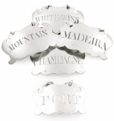 A GROUP OF SILVER WINE LABELS