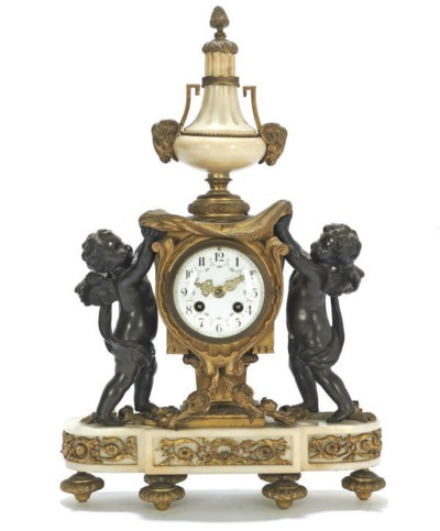 A FRENCH MARBLE AND GILT-METAL
