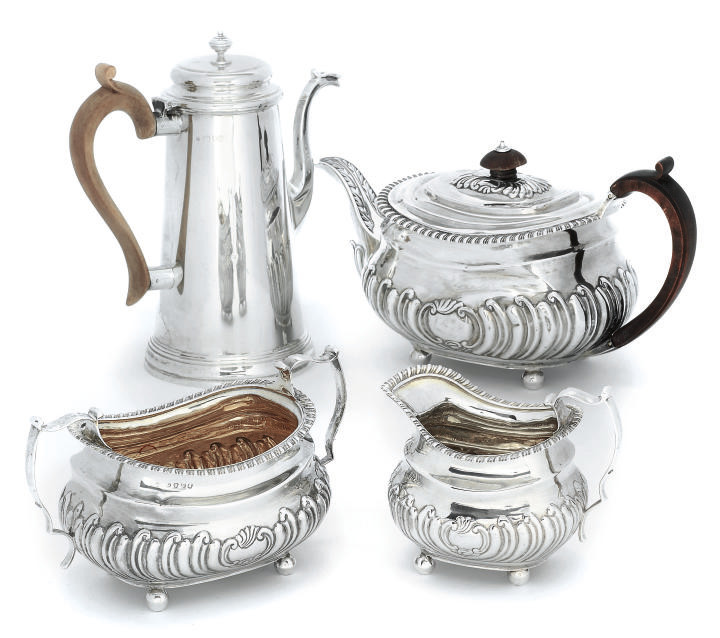 A GEORGE III SILVER THREE-PIECE TEA SET