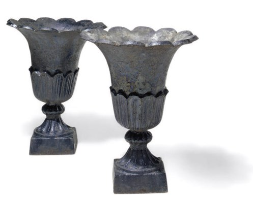 A PAIR OF PAINTED CAST-IRON UR