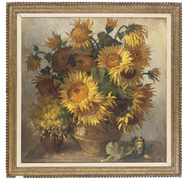 Sunflowers and other blooms in pots on a table
