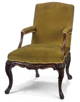 A GEORGE II WALNUT ARMCHAIR