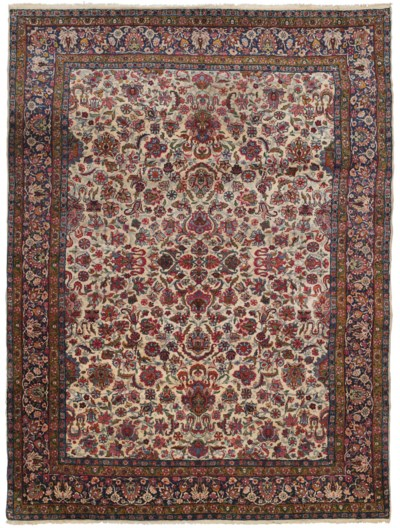 A KIRMAN LAVER CARPET, SOUTH P