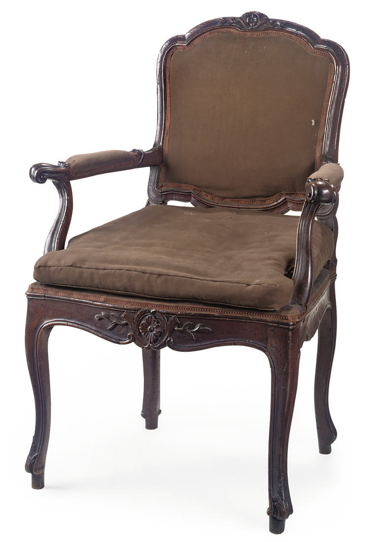 AN ITALIAN WALNUT ARMCHAIR